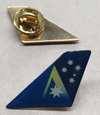 "LAPEL BADGE: ""Tail"""